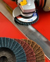 Finishing Flap Discs blend and grain-in stainless steel welds.