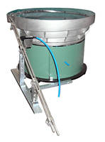 Vibratory Bowl Feeder is designed for feeding pen caps.