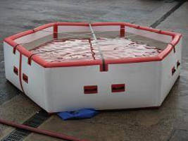Inflatable Waterwall Dam stores water for remote firefighting.