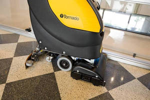 Walk-Behind Scrubber uses less water and chemicals.