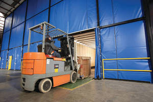 Flexible Fabric Wall Systems enclose loading dock areas.