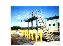 Stationary Platforms service trucks and tank cars.