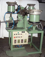 Assembly Machine consists of 3 vibratory bowl feeders.