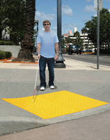 ADA Compliant Safety Pads warn of upcoming intersections.