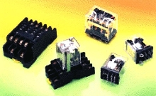 Relays provide power and logic control.