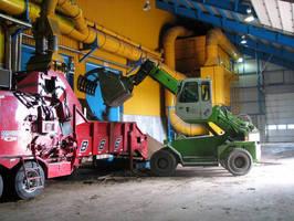 Sennebogen Multihandler Works Triple-Duty in Alternative Energy Project at Ciment Québec