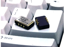 Voltage Controlled Crystal Oscillator fits SONET applications.