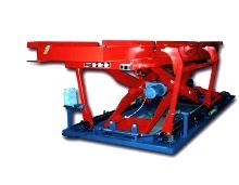 Stacker/Destacker handles skids in automotive assembly line.