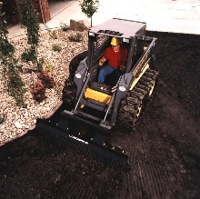 Skid-Steer Attachment has large scarifying teeth.