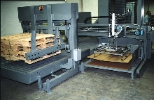 Pallet Pad Placer puts corrugated sheet down.