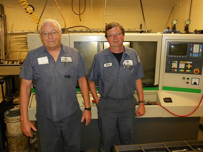 Paul Carrignan (left) and Ron Krutz have been running New England CNC for 26 of its 54 years in business. Credit: Pat Toensmeier