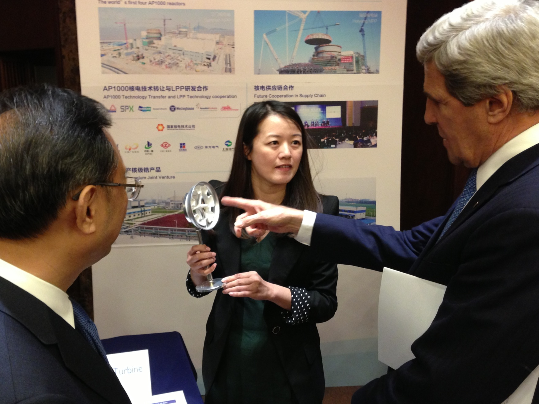 China State Councilor Yang Jiechi and U.S. Secretary of State John Kerry inspect exhibits in Beijing detailing joint U.S.-China energy projects.